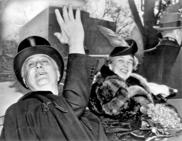 President Franklin Delano Roosevelt and First Lady Eleanor Roosevelt return to the White House from church on Inauguration Day in 1941.
