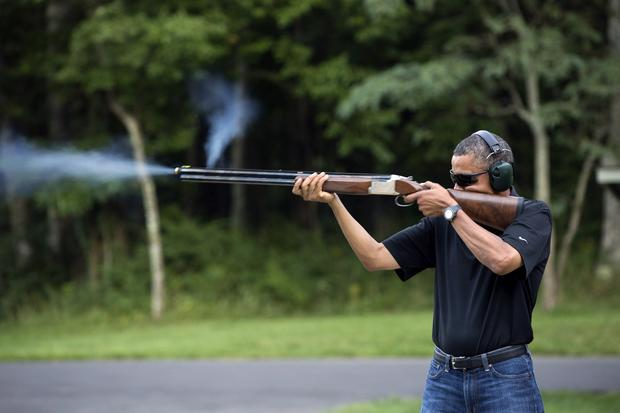In this Aug. 4, 2012, photo released by the White House, President Obama shoots clay targets on the range at Camp David, Md.
