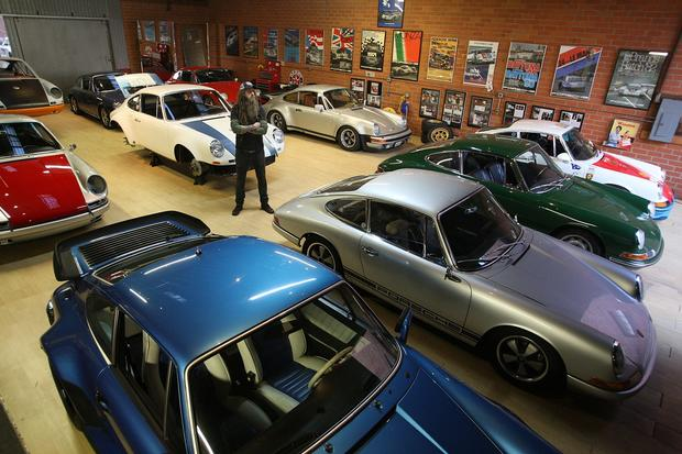 Magnus Walker with some of his vintage Porches in his warehouse.