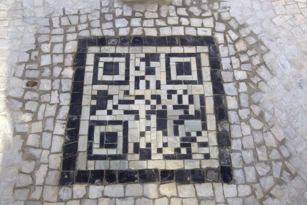 A QR code made from stone tiles at Arpoador rock.