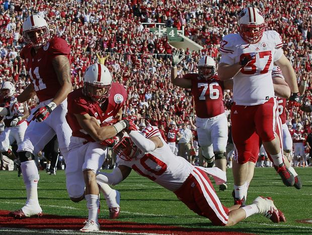 Cardinal running back Kelsey Young drags Wisconsin defensive back Devin Smith into the end zone in the first quarter Tuesday.
