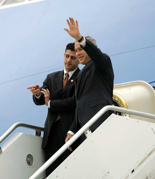 President Bush waves as he steps off Air Force One with Rep. Paul Ryan, left, R-Wisc., in Milwaukee.