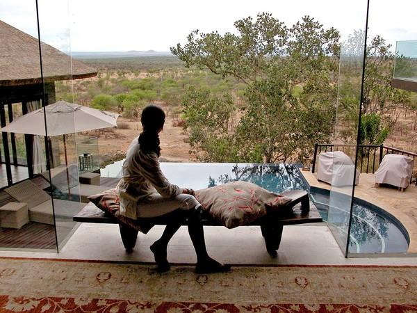 "Bilila Lodge Kempinski  allows visitors to ""just sit on your balcony and soak up the excitement"" of seeing wildlife,  a hotel chain executive says.  Bilila, which opened a year ago, takes advantage of animal migratory patterns in Serengeti park."
