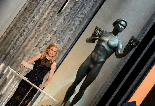 "Nicole Kidman presents the first Screen Actors Guild award Sunday at the Shrine Auditorium in Los Angeles. She accepted the award for male actor in a supporting role for ""Lincoln's"" Tommy Lee Jones, who was absent."