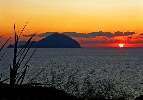 The sun sets beyond Filicudi, another Aeolian island west of Salina in the Tyrrhenian Sea.
