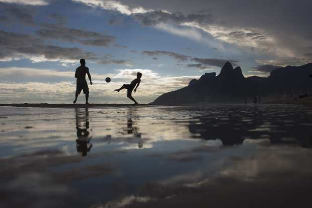 The sun sets on another day at Rio de Janeiro's Ipanema beach.