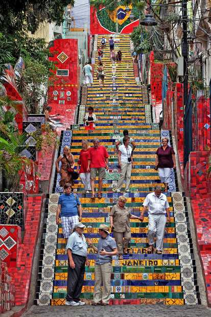 Residents check out the colorful Escadaria Selarón stairway in Rio de Janeiro, the work of Chilean-born painter and sculptor Jorge Selarón.  The 250-step stairway, which the artist has been working on since 1990,  features more than 2,000 tiles collected from around the globe.