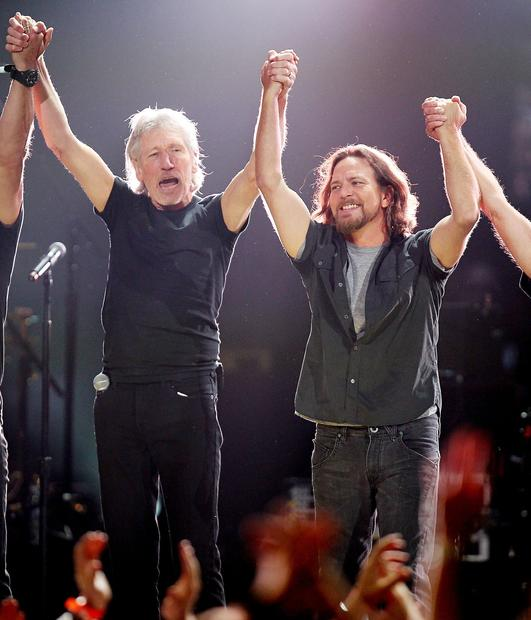 Roger Waters, left, and Eddie Vedder at the 12-12-12 concert.
