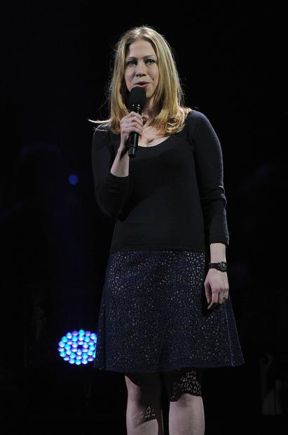 Chelsea Clinton speaks at the 12-12-12 concert.