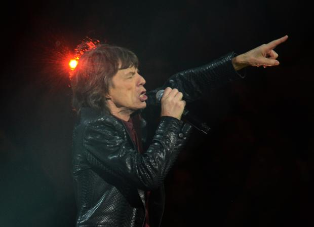 Mick Jagger of the Rolling Stones performs at the 12-12-12 benefit concert.