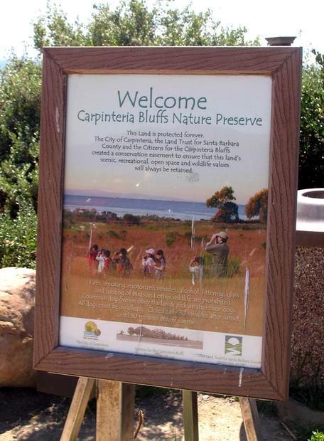 "A sign at Carpinteria Bluffs declares that ""This land is protected forever."""