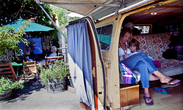 A favorite seat at Paula's is the one created inside an old surf van. Amber Morris and daughter Ediza, 5, await their breakfast there.
