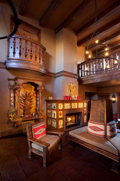 The lobby at Hotel Chimayo. The vibrant 56-room inn is full of villagers' handiwork, such as woven bed coverings and rustic crosses that adorn the walls.