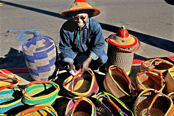Alioune Kane sells baskets from Ghana at a farmers market.
