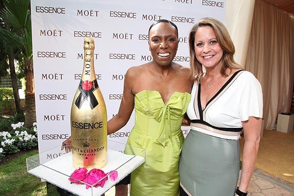 Mikki Taylor, left, and Anne DiGiovanna arrive at the Essence Black Women in Hollywood luncheon at the Beverly Hills Hotel on Feb. 24.