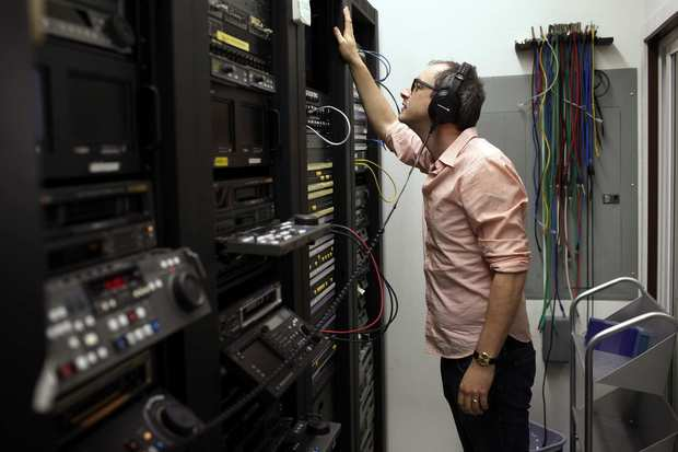 "Road to Sundance: Writer and director Nick McCarthy checks the sound during opening scenes of his movie ""The Pact,"" one last time at Secret Headquarters in Culver City."