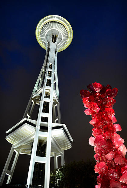The Space Needle, marking its 50th year, towers 605 feet above the city and the colorful new landmark, Chihuly Garden and Glass.