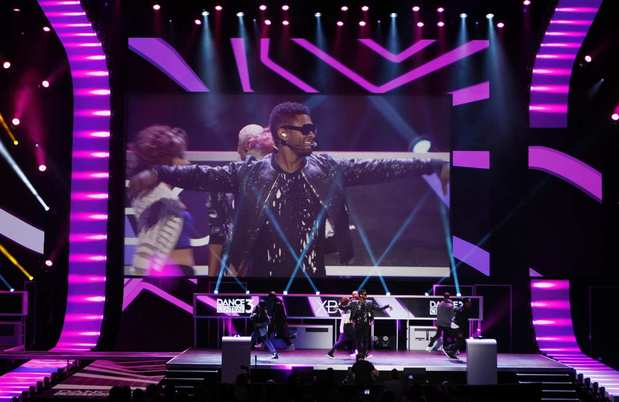 "Singer Usher shows his dance moves for an upcoming Kinect peripheral title, ""Dance Central 3,"" at a Microsoft news conference during E3."