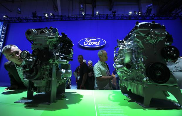 Visitors take a close look at products in the Ford area at the Las Vegas Convention Center for the SEMA Show.