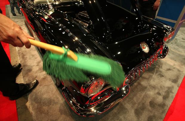 A 1958 Corvette is kept dust-free to show off the shine at the Las Vegas Convention Center for the SEMA Show.