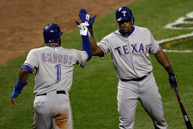Texas shortstop Elvis Andrus, left, celebrates with teammate Adrian Beltre after scoring the go-ahead run during the ninth inning of the Rangers' 2-1 victory over St. Louis in Game 2 of the World Series on Thursday.