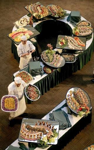 Future chefs set up a buffet at the California Culinary Academy, where diners can sample students' schoolwork.