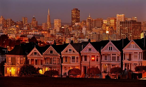 One of San Francisco's most-photographed views: the Victorians along Alamo Square, with the gleaming downtown skyline as backdrop.