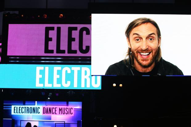 David Guetta, who did not attend the American Music Awards, speaks to the audience in a recorded message after winning for electronic dance music artist.