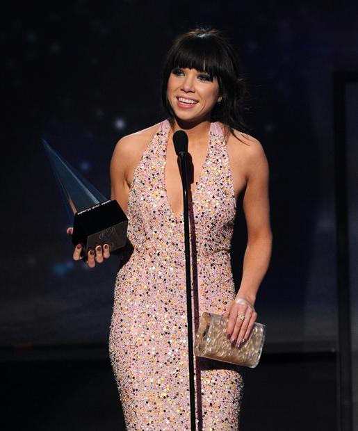 Carly Rae Jepsen accepts the American Music Award for new artist of the year.