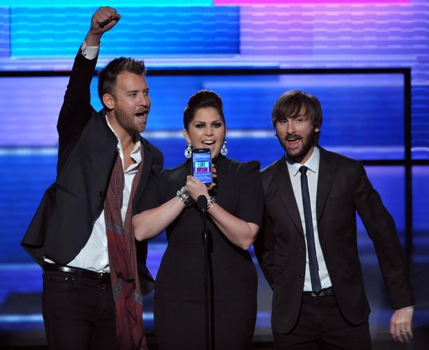 Charles Kelley, left, Hillary Scott and Dave Haywood of Lady Antebellum present an award. The group won favorite country band, group or duo.