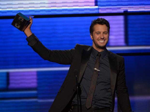 "Luke Bryan accepts the American Music Award for country male artist. ""I'll tell you what, I want to thank my wife for letting me be a big kid out on the road every week playing shows,"" Bryan said, also thanking his fans and his family."