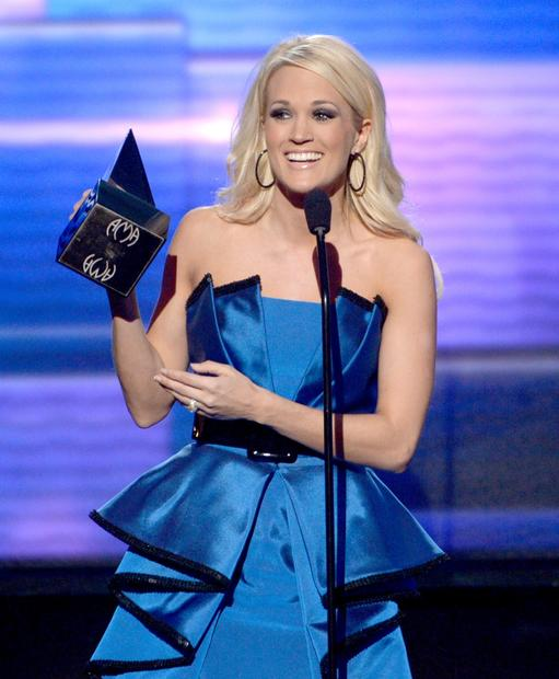"Carrie Underwood accepts the award for favorite country album. It's her fourth win in the category, covering every album she has released. ""I really am so very proud of this album,"" Underwood said. ""I couldn't love my life any more than I do right now."""
