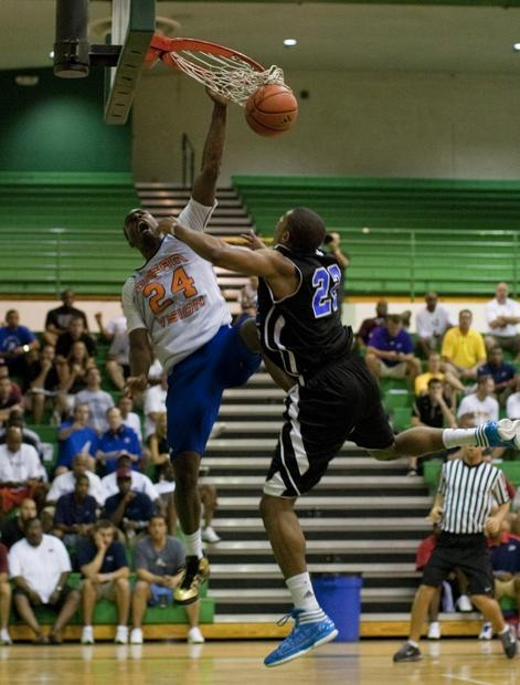 Dream Vision's Shabazz Muhammad dunks against Double Pump Elite during the Adidas Super 64 tournament.