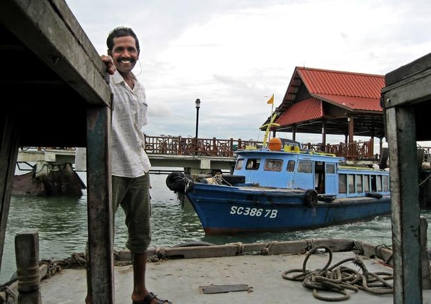 A bumboat docks at Pulau Ubin.