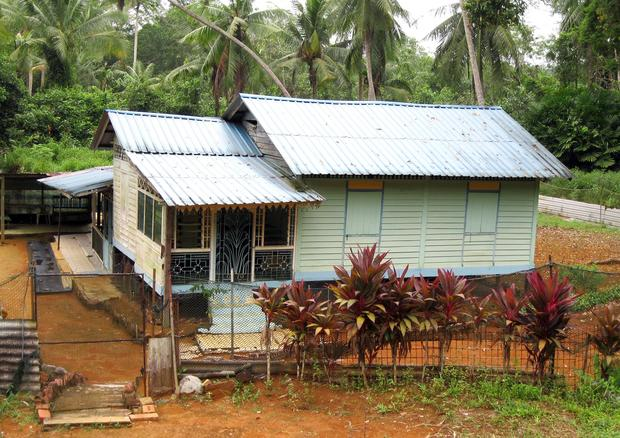 Corrugated-tin-roof homes are common on Pulau Ubin.