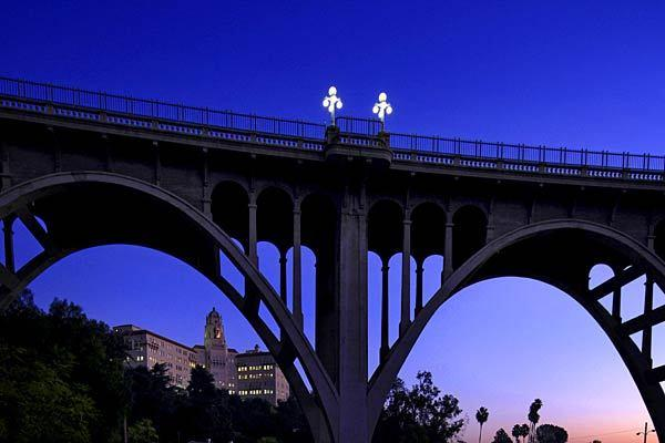 "The Colorado Street Bridge is better known among locals as ''Suicide Bridge."" On the lower left is the old U.S. courthouse (125 S. Grand Ave.), once the Vista del Arroyo Hotel and, before that, a boardinghouse."