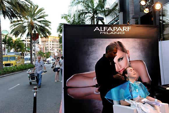 A woman gets a makeover on Rodeo Drive during Fashion's Night Out, an after-hours shopping event.