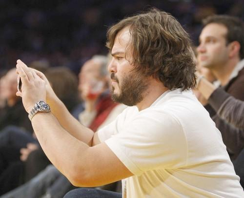 Jack Black snaps some photos during the Lakers-Jazz game.