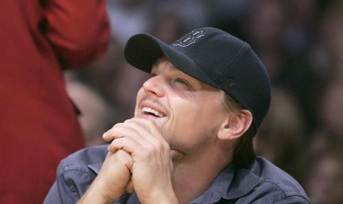 Leonardo DiCaprio takes a glance at the scoreboard during a break in the action between the Lakers and Phoenix Suns.