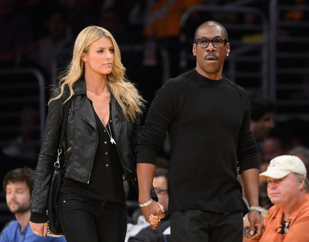 Eddie Murphy and Australian model Paige Butcher arrive for a Lakers-Suns game.