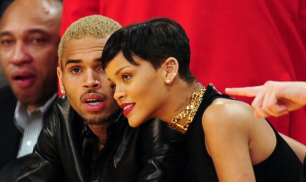 Chris Brown and Rihanna sit side by side at the Lakers-Knicks game on Christmas Day.