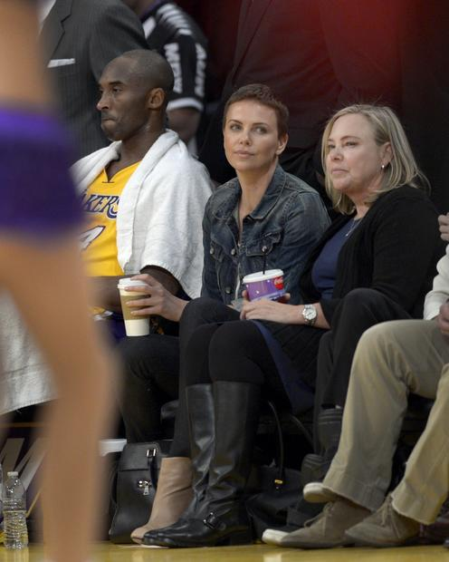 Charlize Theron and her mother, Gerda, get courtside seats next to Lakers All-Star guard Kobe Bryant during a game against the Thunder.