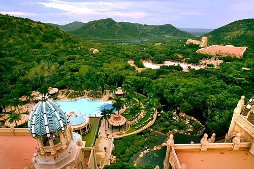 The Palace of the Lost City, foreground, one of four hotels in Sun City, is surrounded by lush landscape.