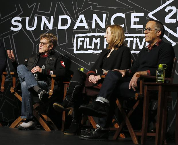 Actor and festival founder Robert Redford, left, Executive Director of the Sundance Institute Kerry Putman and Sundance Festival Director John Cooper attend a news conference at the start of the 2013 Sundance Film Festival.