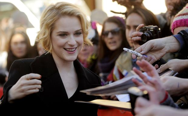 "Evan Rachel Wood, a cast member in ""The Necessary Death of Charlie Countryman,"" greets fans."