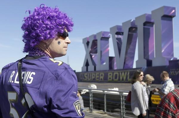 Baltimore Ravens fan Cal Wheaton in game-day garb near a barge along the Riverwalk in New Orleans on Sunday.