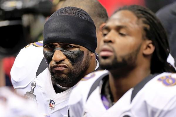 Ravens linebacker Ray Lewis, who will retire after a storied 17-year career when the game is over, and receiver Torrey Smith put on their game faces before the start of Super Bowl XLVII on Sunday at the Superdome.