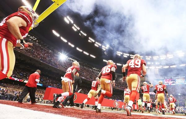 San Francisco 49ers players take the field before the start of Super Bowl XLVII on Sunday at the Superdome in New Orleans.