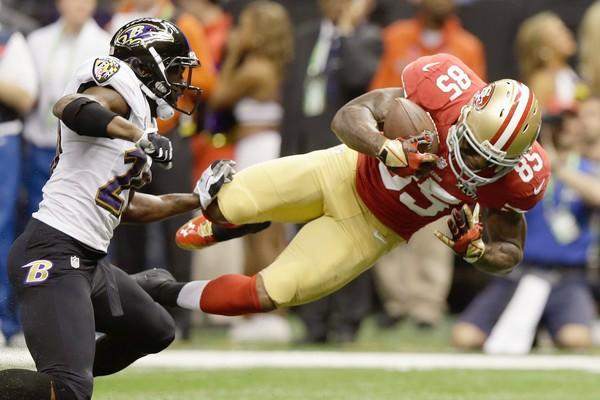 49ers tight end Vernon Davis goes airborne after making a catch against the Ravens in the first quarter Sunday.