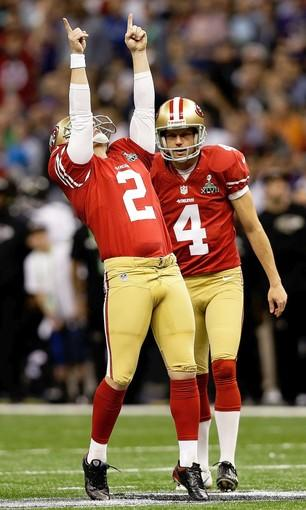 49ers kicker David Akers (2) celebrates with holder Andy Lee after kicking a field goal against the Ravens in the first quarter Sunday.